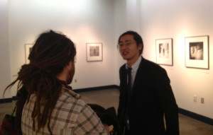 Photographer Ryota Kajita answers questions from viewers at opening reception.  -Photo by Micheal Ives, ExtremeAK