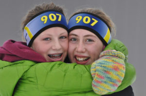 Nanook skiers embrace each other after winning the NCAA Regional championships. Photo by Bert Boyer