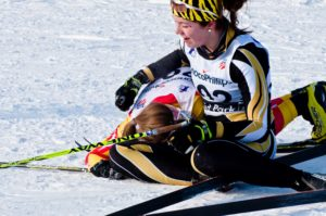 Skiers get well-deserved rest after a full day of NCAA championship racing. Photo by Bert Boyer