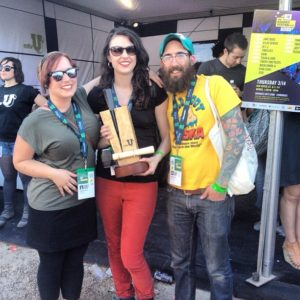 Rebecca File, Annie Bartholomew and Brady Gross pose with their MTV Woodie award they won at South by Southwest in Austin, Texas earlier this month. This photo was taken from KSUA 91.5 FM College Radio & KSUA TV's Facebook page and is their property.