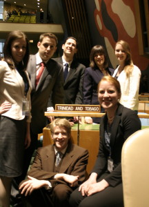 UAF Delegates at UN building. Standing left to right: Bekah Schmidt, Dan Strigle, Erik Hernandez, Shelby Surdyk, Ayla O' Scannell. Seated from left to right: Sam Allen, Mari Freitag. Not pictured: Bryant Hopkins and head delegate Chelsea Holt.