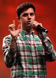 Rapper George Watsky performing in a slam poetry competition.