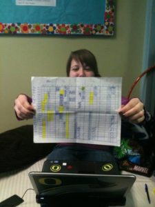 Tiana Elikns displays a copy of the schedule that her group uses to decide who will hold the line.