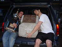 Two UAF students with the coveted Tradition Stone. From Left: Jesse Manchester, Tradition Stone, Ethan Stephens. Photo Courtesy of Jesse Manchester