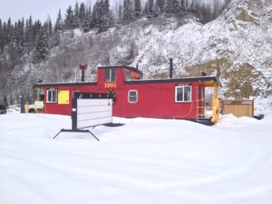 The Goldhill Express caboose sits vacant in the snow waiting for Spring.  Photo by Micheal Ives.
