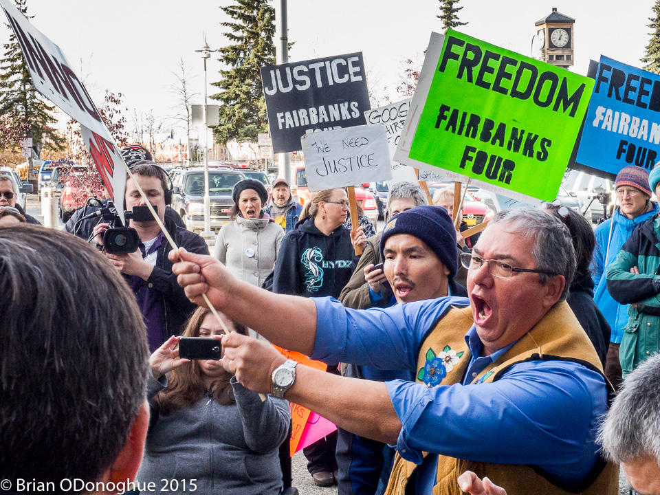 Victor Joseph, president of the Tanana Chiefs Conference, leads Fairbanks Four supporters dancing for justice.